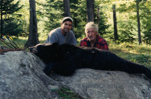 Kevin and Man with Bear on Rock