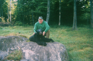 Man with Bear on Rock